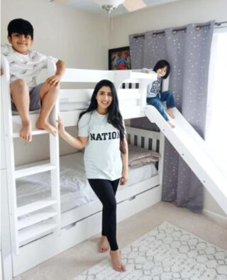 This mom chose wisely for her boys. Maxtrix twin-size bunk beds with a slide, bedside tray, and trundle bed for a shared boys' room.