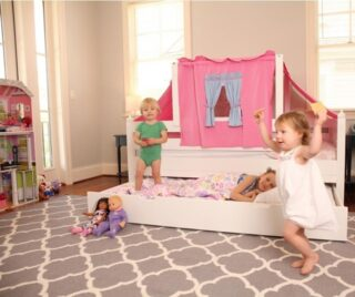 Imagination plus friends add up to a good time in a bedroom with a trundle bed. Match your children's energy with games and the little ones will sleep at night.