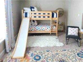 There is no problem getting out of the top bunk here.  A bedroom with a bunk bed can provide delightful options for children and their parents.