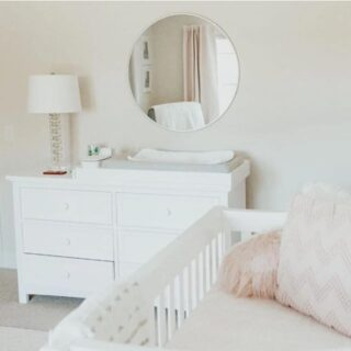 This double dresser features simple lines with room for all the essentials in a baby's life. The room is inspired by Lindsay's nursery.  