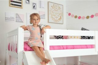 Our Matrix Lofts have so much to offer and are perfect for your growing child. With the detachable slide, tower, top tent, and curtain you can play it up or (as pictured) play it down for your child's mood. They are available in Natural, White, or Chestnut finish.