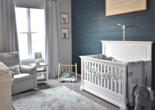 This bold design choice features interplay between fresh white furniture and a dark blue wall. The room is known as Mary's nursery for the lucky baby who lives here.     #RoomsToGrow #Lifestyle #Instagood #Children #ParentingLife #Kids #YouthFurniture #ShopRhodeIsland  #Family #LetThemBeLittle #Parenthood #BabyCribs #ModernNursery #ClassicNursery #NurseryInspiration  #BabyRoom #SimpleNurseries #ElegantNurseries #NurseryInspo #PackageDeals #ConvertibleCrib